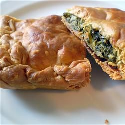 SPANAKOPITA is a spinach and traditional feta cheese pie in layers of thin filo dough.