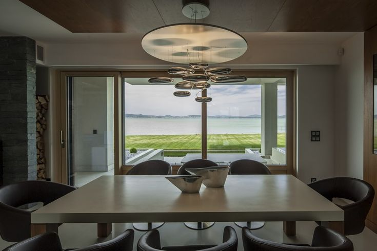 Family Lake Villa in Two Floor Design Style: Unforgettable Lake View Displayed In Dining Room Area Of Balatonboglár Home With Modern Furnitu...