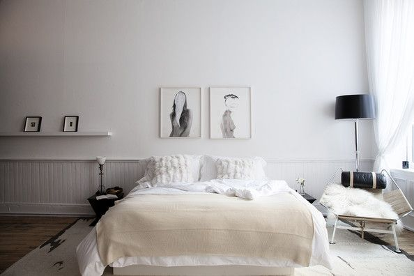 Modern Bedroom - A bedroom done in white; framed artworks on the wall