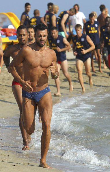 Raffaele Palladino of Parma FC trains on the shore during a Parma FC Pre-Season Training Session at Rosa Marina Resort on July 8, 2013 in Ostuni, Italy.