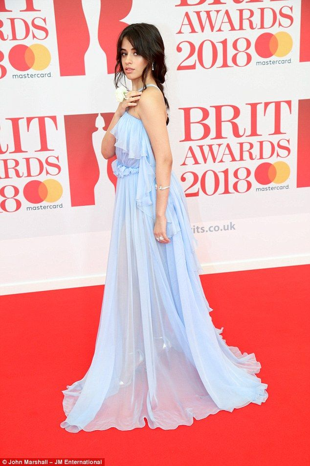 The 20-year-old American songstress showed off her slender physique in the soft blue gown after arriving on the red carpet for the awards event in London's O2 Arena on Wednesday.