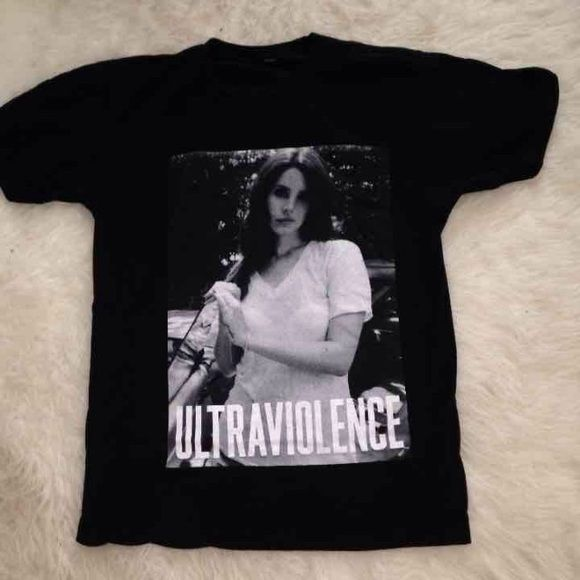 Lana Del Rey Concert Tee Lana Del Rey Limited Edition Concert Tee Size Large but I've worn it and I'm a small. Bought at 2014 Tour at Austin City Limits. Price is negotiable. Tops Tees - Short Sleeve