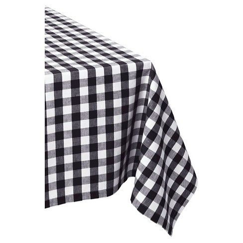 Protect and dress up any table with this beautiful Black & White Checkers Tablecloth by Design Imports. Use this contemporary tablecloth to bring effortless style and warmth to your modern dining room. This monochrome plaid tablecloth will save your table from scratches, spills and stains. This tablecloth is great for both everyday or occasional use. It is quite durable and can be used for years to come.
