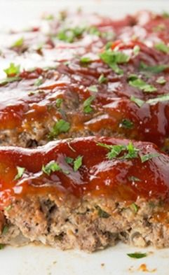 This easy recipe for flavorful meatloaf is made with ground beef and topped off with a super simple sauce. The leftovers are perfect for making a sandwich! Meatloaf is a classic, and this recipe is delicious.