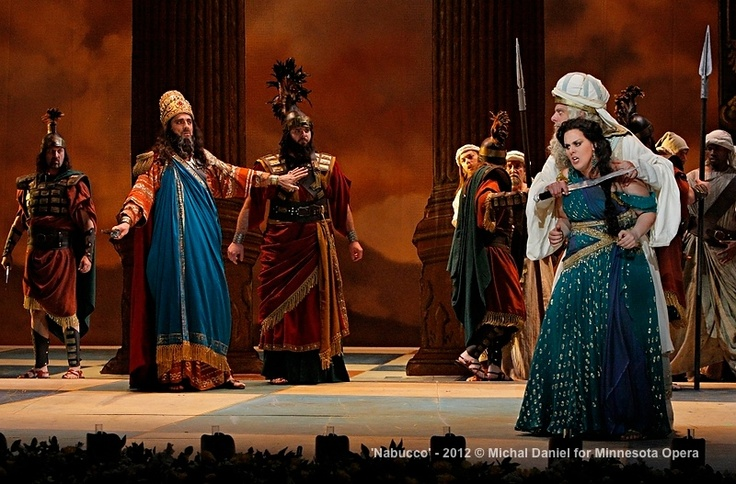Jason Howard as Nabucco, King of Babylon, John Relyea as Zaccaria, High Priest of the Hebrews, Victoria Vargas as Fenena, younger daugher of Nabucco and Company in the Minnesota Opera production of Nabucco.