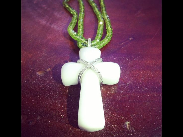 Today I made a cross using a high tech polymer and an 18ct white gold overlay with handset diamonds and faceted peridot beads ...