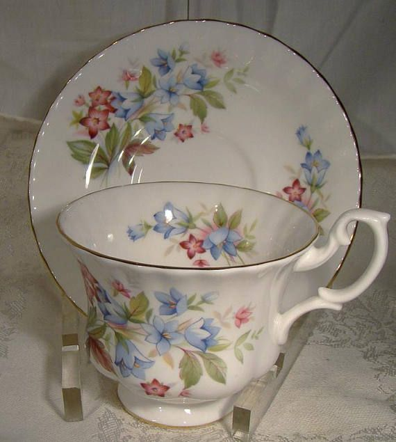 A Royal Albert Bourton tea cup and saucer, part of the Summertime Series by this company. This vintage English bone china 2-3/4 tall teacup and matching 5-1/2 saucer have floral arrangements inside and out in red, green and blue. It is the Montrose shape. It is in excellent
