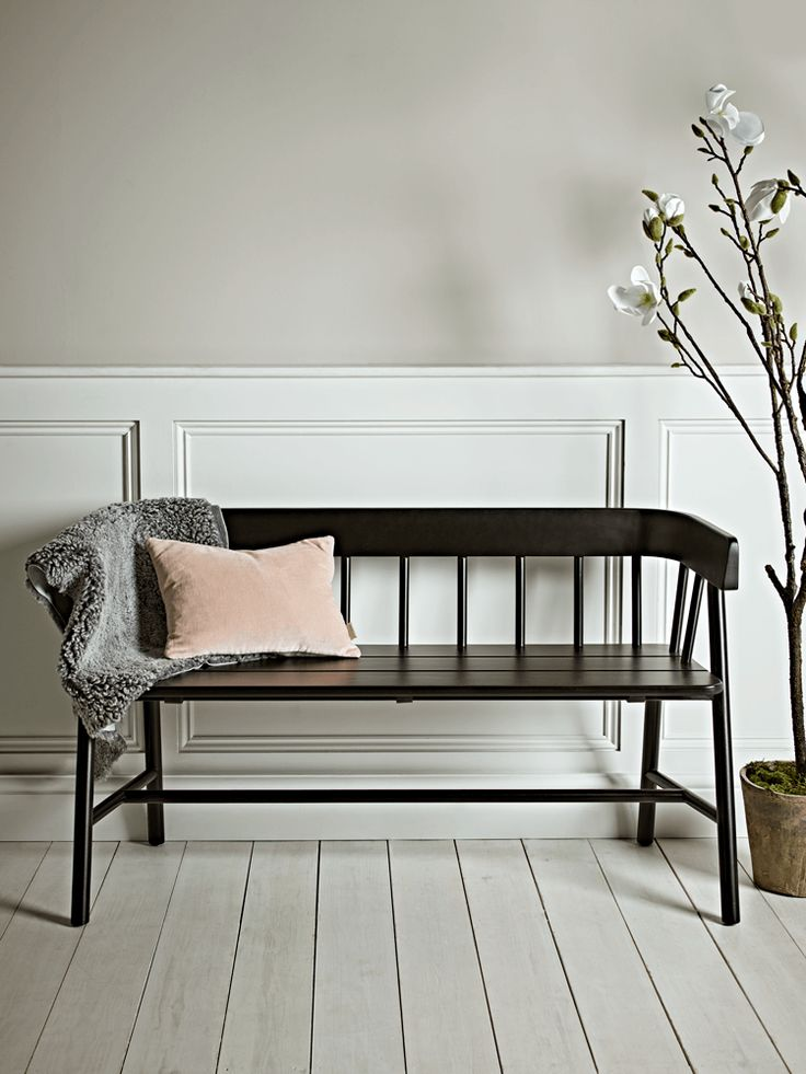 Beautifully handcrafted from reclaimed teak with a black painted finish, our elegant wooden bench has a simple spindle back and a deep seat for added comfort. This large, Scandinavian-inspired bench has been designed especially for your comfort and will make the perfect feature in your hallway, kitchen or garden room. Some variation in finish may occur.