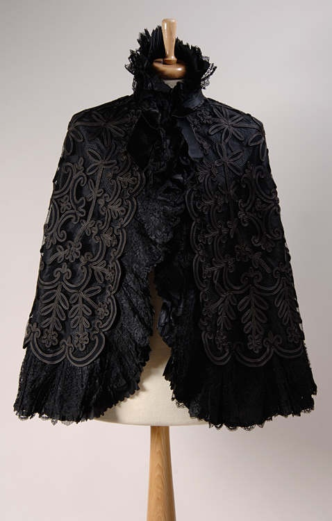 Victorian black silk cape with braid appliqued net, ruffled border and stand collar, late 19th century