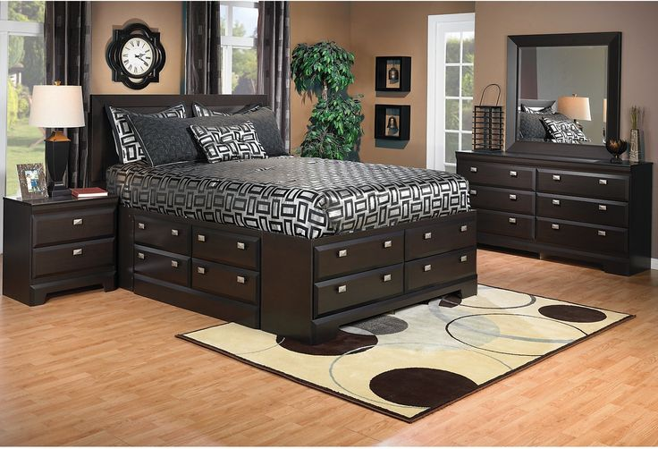 You will have storage aplenty with this innovative storage bed and bedroom set. The dark saddle birch finish gives this bed a contemporary look, while the pewter drawer handles complements the finish well. The 12 drawers in the bed base are dust-proof, and can hold a wide variety of household items! This package includes a queen bed with storage, dresser, mirror and a nightstand. Simply modern, the Yorkdale embodies style in every aspect of the furniture.  $1669