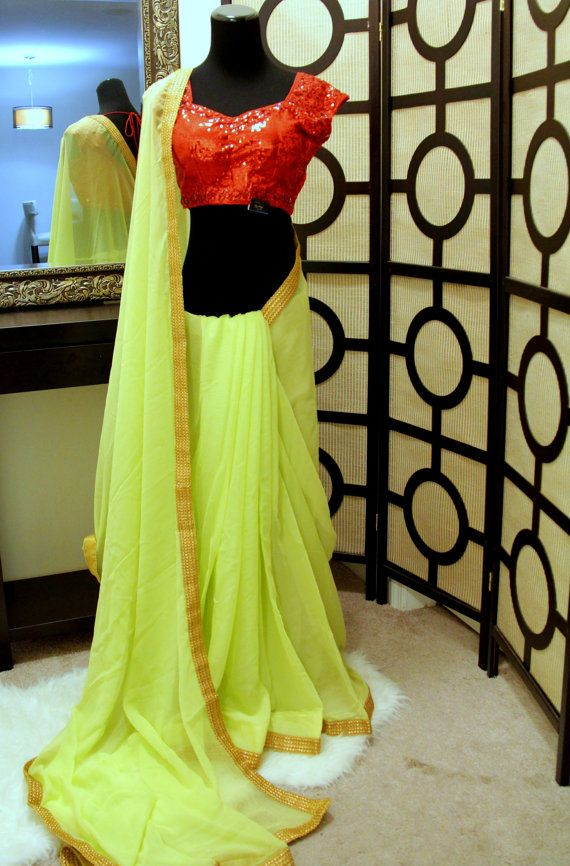 Lime green crinkle chiffon saree with red sequence by Brioka