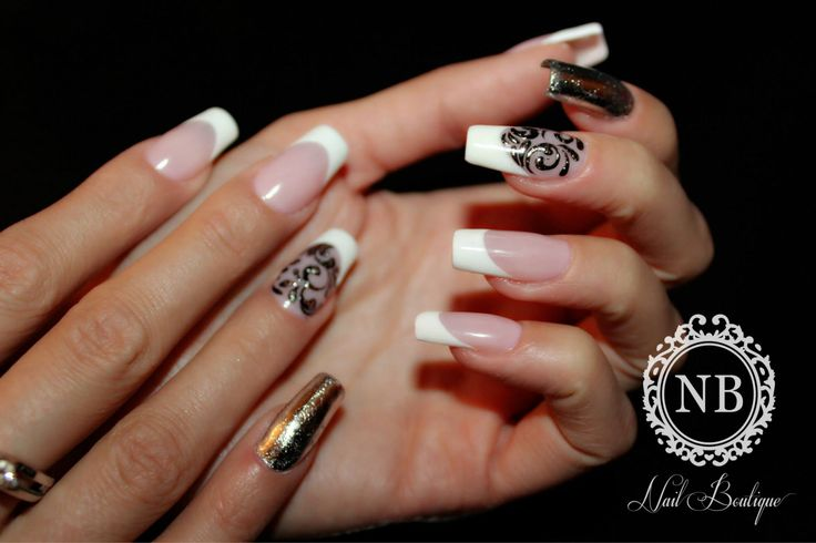 french manicure with black manual painted model and a touch of golden nailpolish