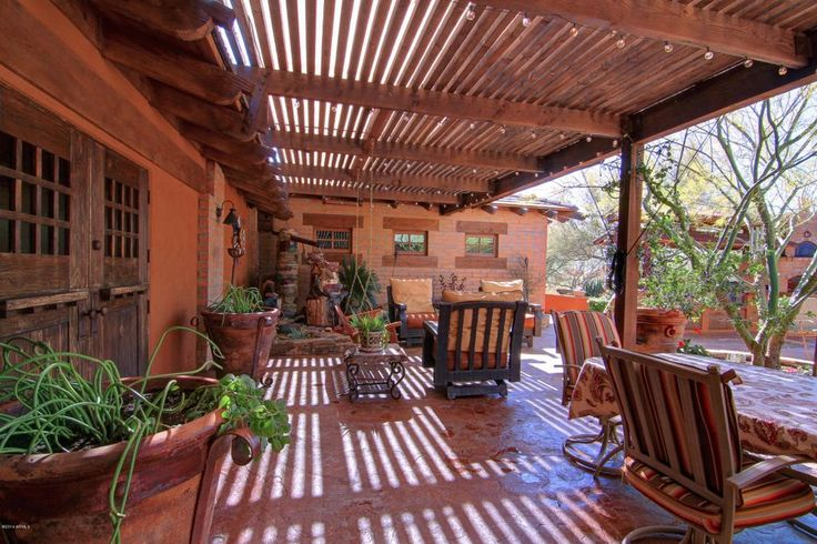 Southwestern Porch with Trellis, exterior stone floors, Porch swing