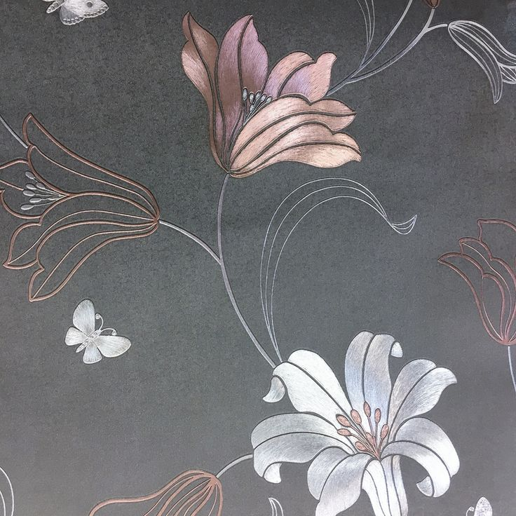 An elegant heavy weight metallic floral wallpaper with rose gold and silver metallic flowers, leaves and butterflies on a smoothcharcoalbackground. The metallic foil looks stunning as it shimmers inthe light.