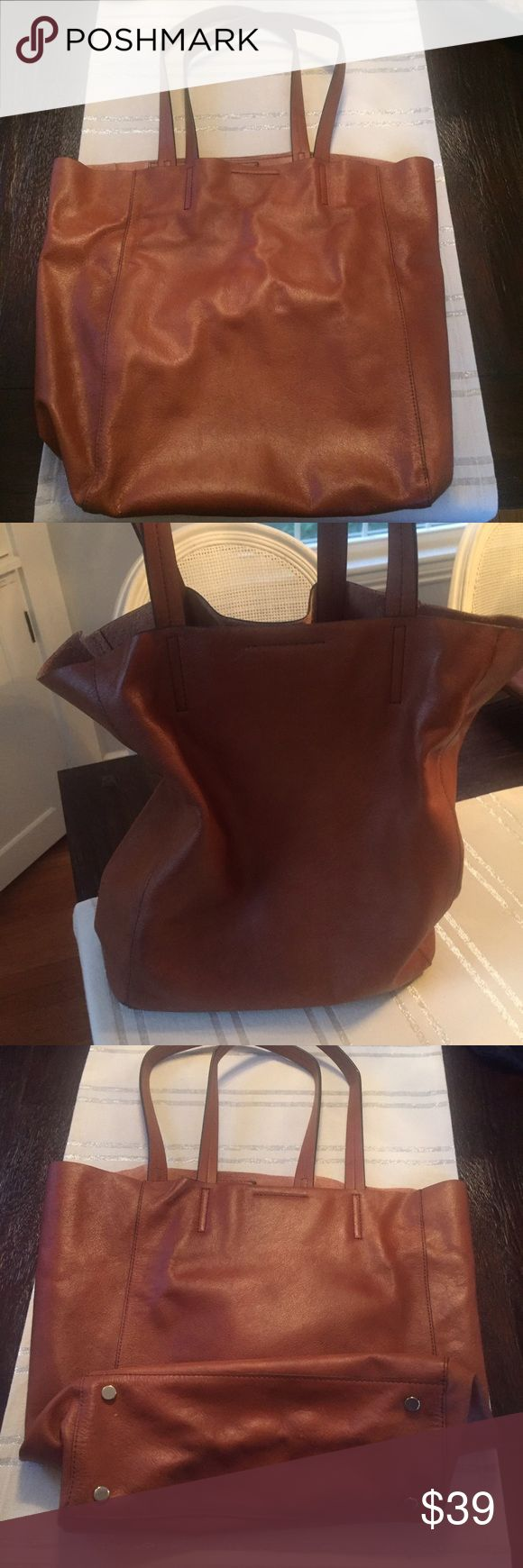 Banana Republic Leather Tote (computer bag) Banana Republic Brown / Luggage Brown Tote bag, that can be used as at computer bag. Buttery leather, with inside pouch pocket. Used once, no sign of wear, perfect condition. Banana Republic Bags Totes