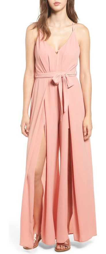 split leg jumpsuit by Socialite. Dramatic slits from hip to hem create breezy movement in this beautiful rose-hued jumpsuit topped with a strappy open...