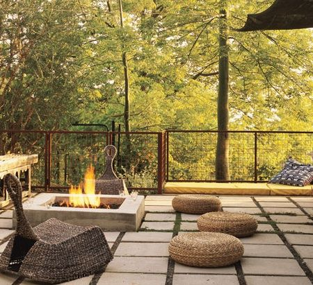 Geometric patterns repeat in this patio space. There is ample seating around the fire pit for evening parties.