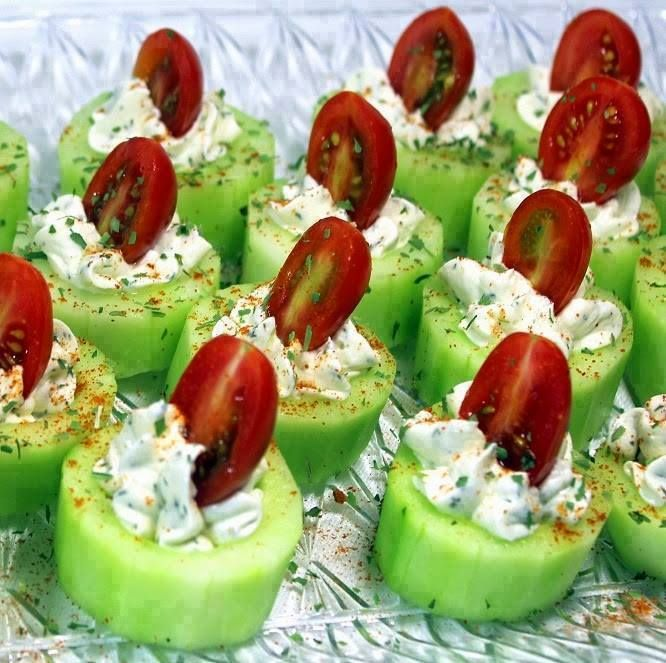 Cucumber Bites with Herb Cream Cheese and Cherry Tomatoes Needed: 4 Ounces (1 Brick) Cream Cheese, Softened to room temperature 1/4 Cup Ranch Dressing (Yes, good old Hidden Valley) 2 TBS Dill (can use other spices... Thyme is excellent also)... 3-4 Long Cucumbers. skinned and Slice into thirty 1 inch slices 15 Cherry Tomatoes, sliced in half Additional Sprinkle of Salt (to Taste, Careful, little goes a long way) Additional Sprinkle of Spice (same as used in Cream Cheese) for Garnish…