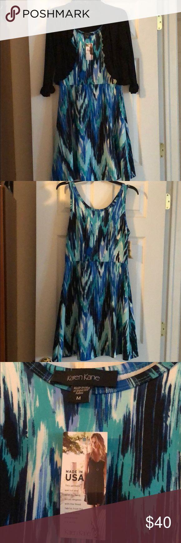 NWT Karen Kane A-line Dress Karen Kane stretchy, comfortable, A-line dress. Hits above knee. Shades of blue/black/white design, Polyester/Spandex blend Shrug not for sale Karen Kane Dresses