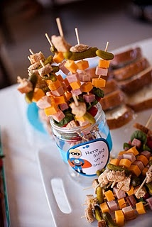 I like this idea for our wedding reception. Smaller chunks of meat, cheese and pickles on a skewer, instead of platters. I could even make it ahead by a day or two and keep it in the fridge instead of paying like $75 per deli platter from the grocery stores. Ack!