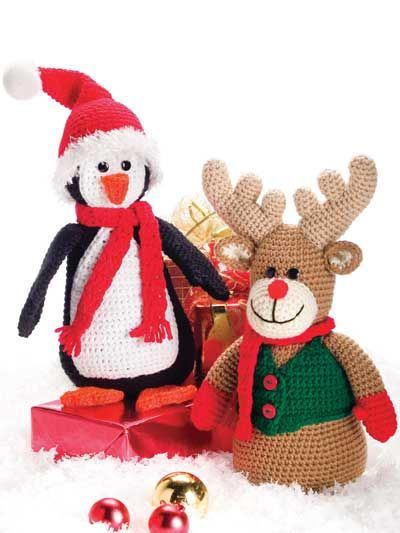 "Get a head start on your holiday decorations with this adorable duo that will add whimsical charm to your home. This e-pattern was originally published in the September 2007 issue of Crochet! magazine. Size: 14""H. Made with medium (worsted) weight yarn and size G/6/4mm hook. Skill Level: Easy"