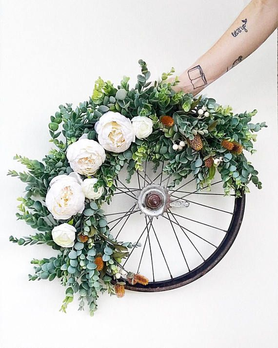Another Vintage Bicycle Beauty! Topped with Succulent garland and white peonies! Wreath size will vary depending on what vintage bike wheels are in stock. Wheels are acquired while antiquing and scouring vintage markets, therefore, making them truly unique! I cannot guarantee any