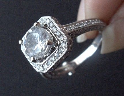 So similar to mine, but with round diamond instead of princess cut