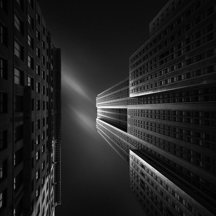 Dutch photographer Joel Tjintjelaar transforms urban architecture into breathtaking abstract works of art. Rather than capturing a traditional image of the Empire State Building, revealing its extraordinary height, Tjintjelaar takes creative liberties to mask the imposing extent of its towering stature and opts to play with the light bouncing off the building's textured facade.