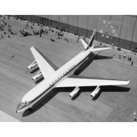 Aerial view of Douglas DC-8 airplane at airport Canvas Art - (24 x 36)