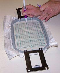 Marking the Sticky machine embroidery stabilizer.