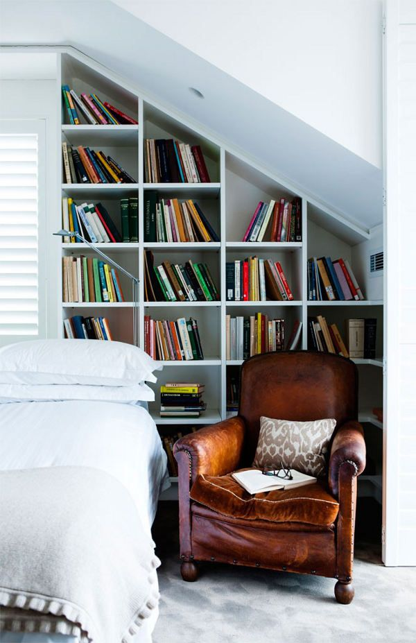 A library in the bedroom or is that sleeping in the library? | Interior Design by Andrew Waller.