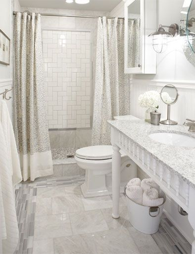 Walk-in tiled standing shower with two shower curtains instead of glass wall or glass door. Looks good! Add style and sophistication to your pint-sized bathroom with a custom made vanity crafted from in-stock lumber parts.