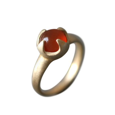 Designer:  Michelle Chang Carnelian cabochon ring in pronged Brass setting…
