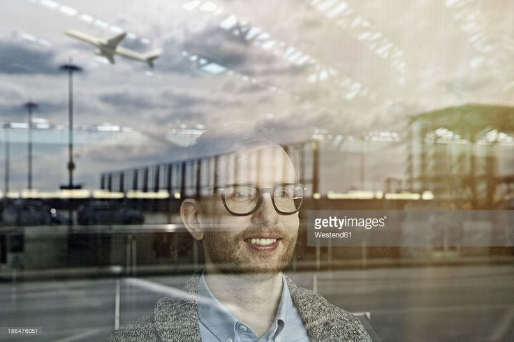 Stock Photo : Germany, Cologne, Mid adult man looking through widow