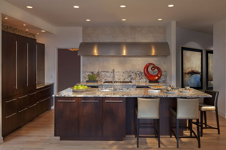 Contemporary Kitchen, Full overlay custom cabinetry in Walnut wood, custom stainless steel range hood, Tropical Treasure granite, Thermador Cooktop, Thermador Warming Drawer