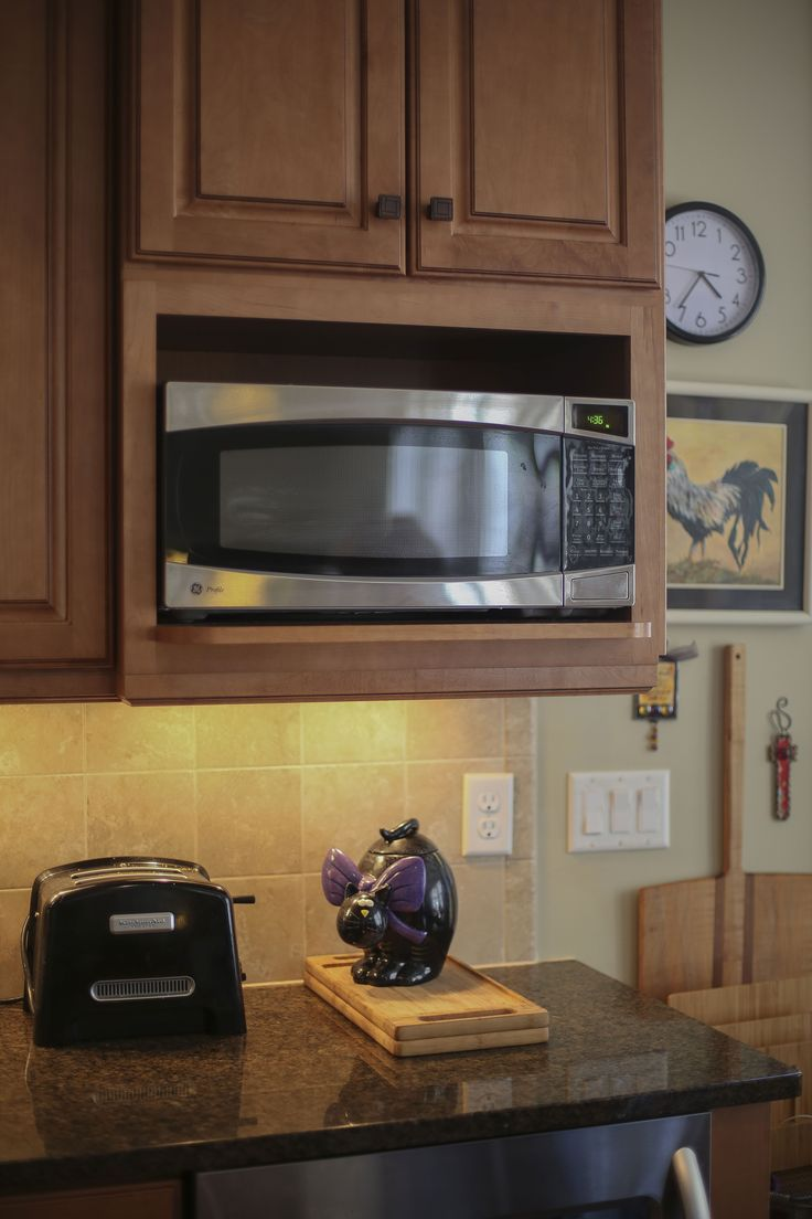 Many home owners chose to mount their microwave in a high location over the stove. A solution like this wall cabinet alcove that works much better. If someone needed to sit, or a child needed to reach, it can easily be relocated to a counter top as used there for as long required. Universally designed homes work better than standard homes. They allow flexibility over time to accommodate many of our life changes.