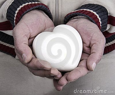 White marble heart in his mens hands