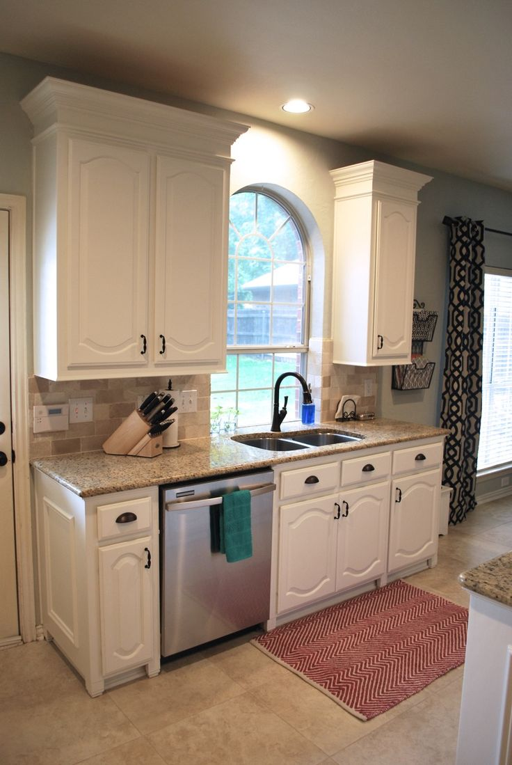 kitchen makeover we painted our dark wood cabinets white using sherwin williams alabaster proclassic oil
