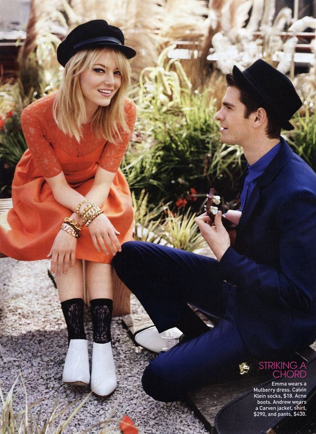 He stares at her,   Emma Stone And Andrew Garfield