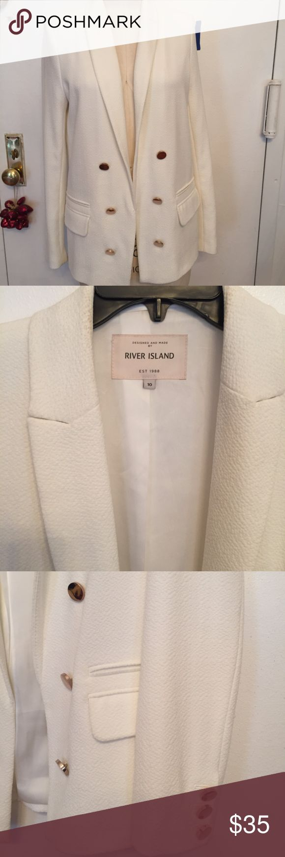 """River Island cream blazer with gold buttons US 6 River Island textured white cream blazer with gold buttons size UK 10 US 6 EUR 36  Excellent condition.   Dry clean only.  Has faux double breasted buttons  Measurements: Shoulder to shoulder back: 15.25"""" Nape to hem: 26"""" Sleeve shoulder to cuff: 26"""" Armpit to armpit flat: 18.5""""  Feel free to ask any questions River Island Jackets & Coats Blazers"""