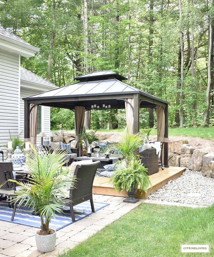 This gorgeous, outdoor oasis is perfect for entertaining! Lounge, dine and have great conversation with family and friends in this beautiful backyard! #backyard #patio #outdoordecorating