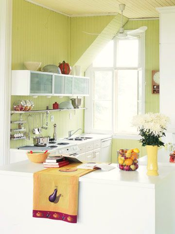 Vibrant Color, Big Impact : Clear the Counters  To keep utensils, supplies, and clutter off the counters, consider using a stainless-steel shelf-and-rail system. Whisks, tongs, and spatulas can hang from metal hooks; spices and pantry items are easy to find when stored in glass canisters.