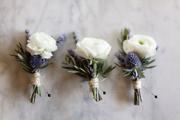 For a chic vintage wedding, summer wedding boutonnieres made with white ranunculus and thistle will go perfectly with simple bouquets and muted color palettes.