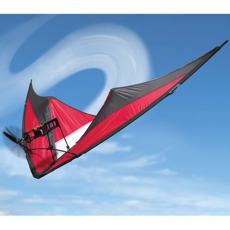 The Motorized Stunt Kite - Hammacher Schlemmer - Its gimbal-mounted engine and propeller provides nimble, multi-directional vector movement in concert with its delta-wing shape that enables quick climbs, loops, and reliable tracking.