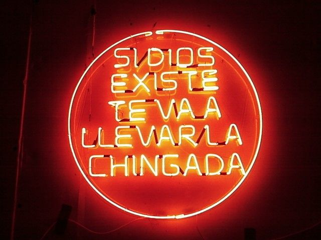 Neon sign in Mexico -Si Dios existe te va a llavar la chingada - photo by Kerry Muir
