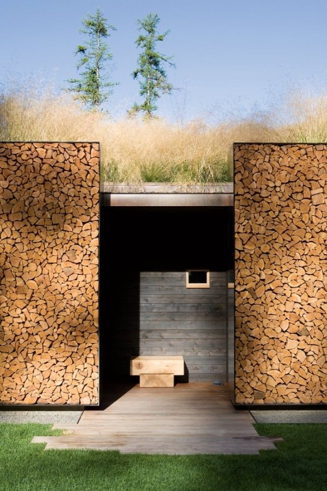 Such a cool idea to decorate the sides of a outhouse with blocks of wood. (Stone Creek Camp by Andersson Wise Architects.)