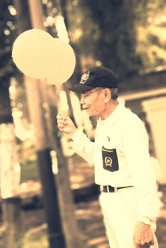 an old man with his ballon