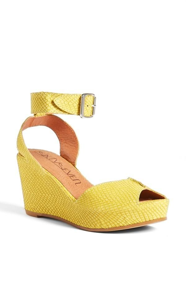 Fun for spring and summer! Bright yellow wedge sandal to pair with a cute little floral dress.