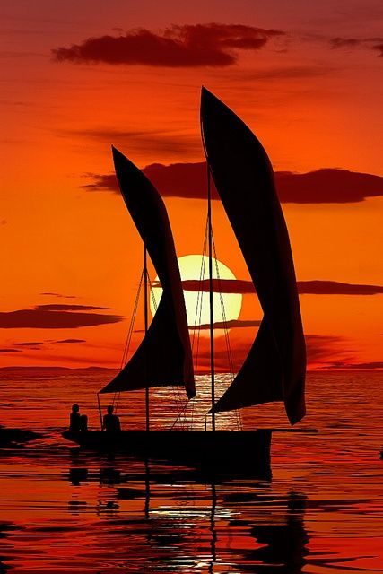 Sailing into the orange sunset.