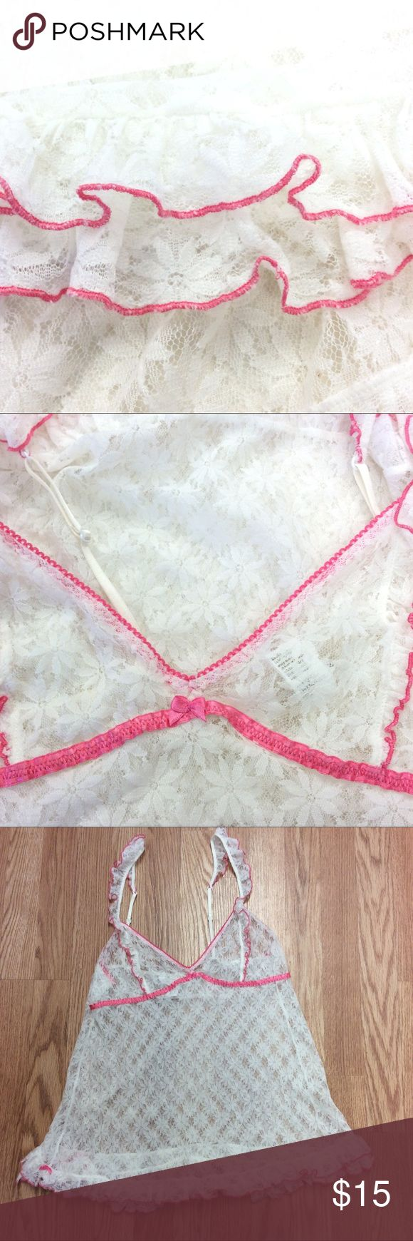 Victoria's Secret pink trimmed baby doll size L Victoria's Secret pink trimmed baby doll size L this sweet baby doll has 2 rows of ruffles trimmed in pink at the hem. Measurements taken with garment laying flat from back, bust is 28 inches length is 15 1/2 inches all measurements are approximate. GUC questions??? Please ask Victorias secret Intimates & Sleepwear Pajamas